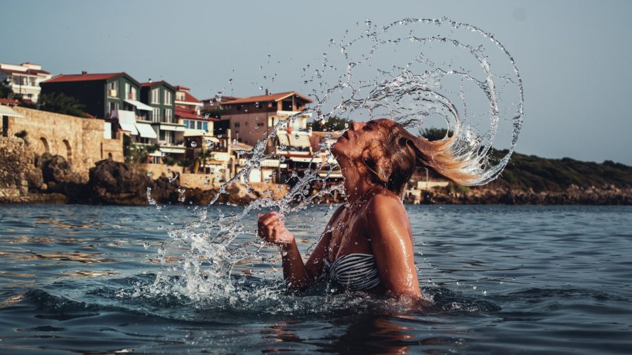 Flicking hair in the sea during summer